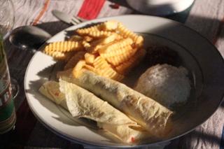 Rollitos rellenos de cordero, patatas y arroz