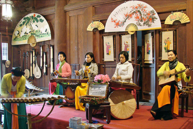 """Orchestre de musique traditionnelle (Hanoi)"" by Jean-Pierre Dalbéra from Paris, France - Orchestre de musique traditionnelle (Hanoi). Licensed under CC BY 2.0 via Commons - https://commons.wikimedia.org/wiki/File:Orchestre_de_musique_traditionnelle_(Hanoi).jpg#/media/File:Orchestre_de_musique_traditionnelle_(Hanoi).jpg"